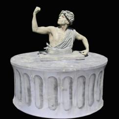 Human_Table_male_greek_stone_pillars.jpg