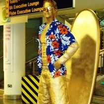 Golden Surfer Living Statue